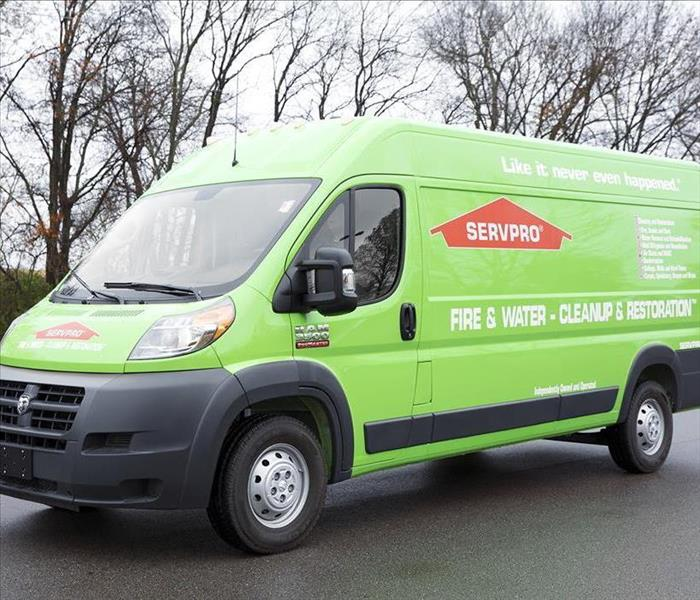 SERVPRO van with trees in the background.